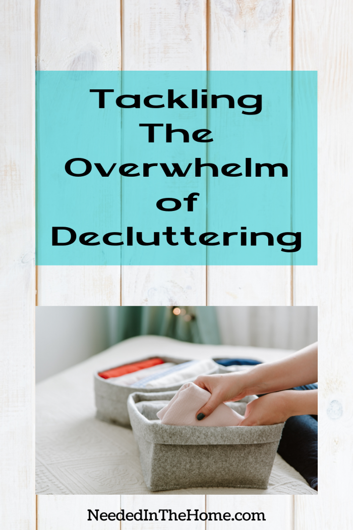 pinterest-pin-description Tackling the Overwhelm of Decluttering folded linens in a cloth bin womans hands neededinthehome