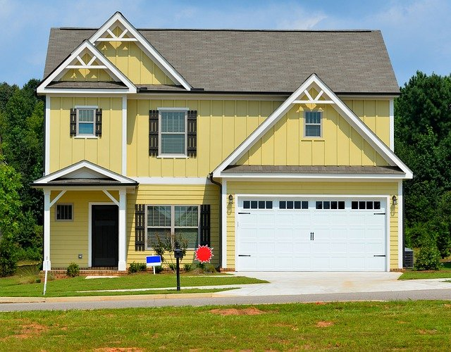 take the stress out of moving yellow two story home with 2 car garage for sale signs