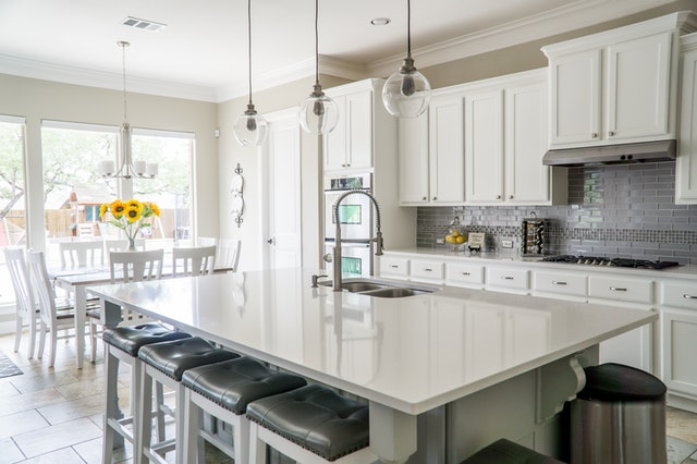 Kitchen on a budget center island stools dining room table chairs flowers backsplash overhead lighting