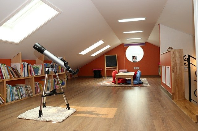 Make the most of your attic space home library shelves books telescope