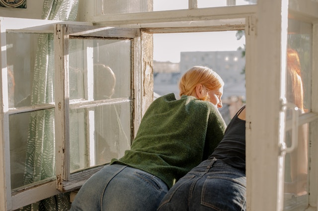 When a home repair comes due people looking out window