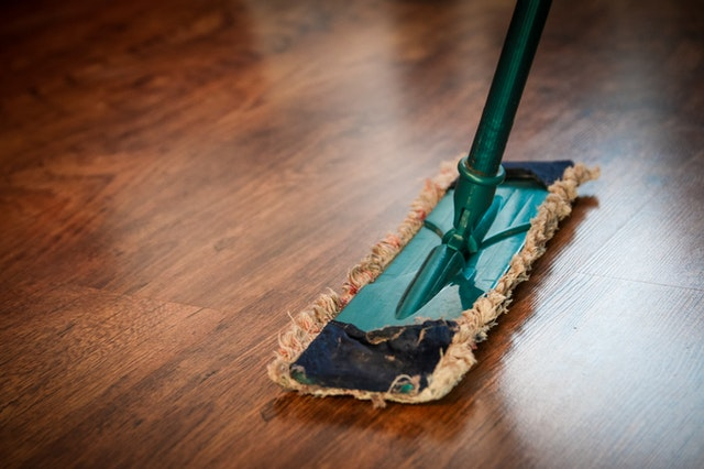 water damage restoration wood floor dry mop