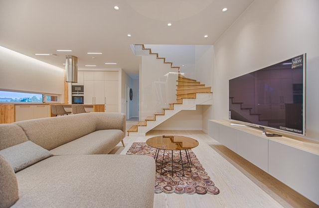 pinterest-pin-description energy efficient check before moving in large open concept living room sofa stairs tv coffee table