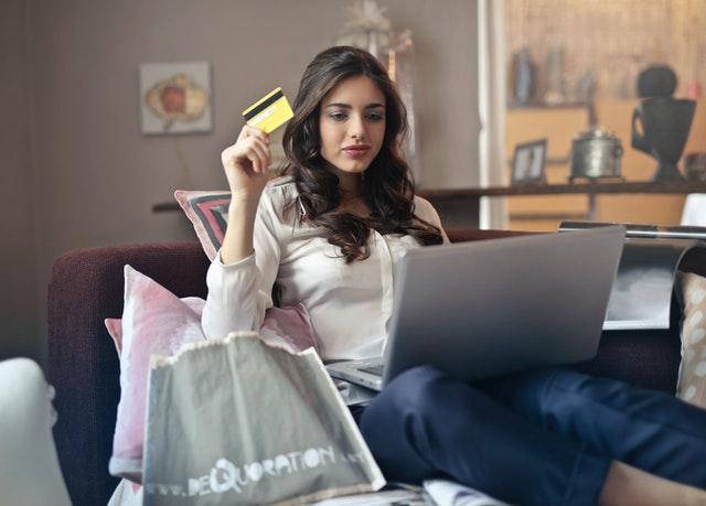 break down barriers online customer woman holding credit card laptop shopping online
