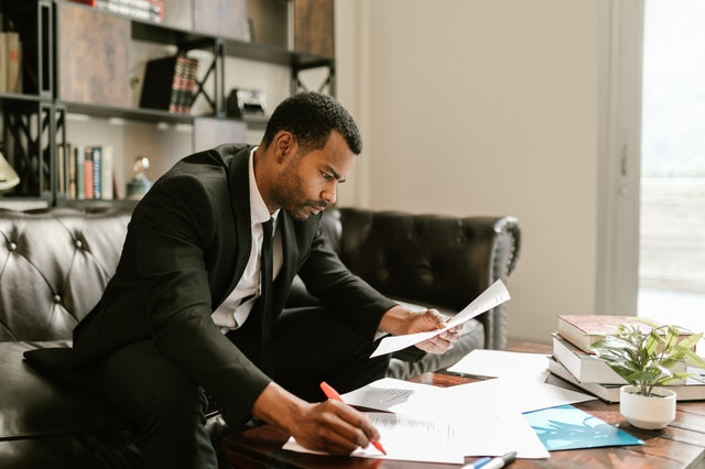 battle debt man looking at invoices making budget plan