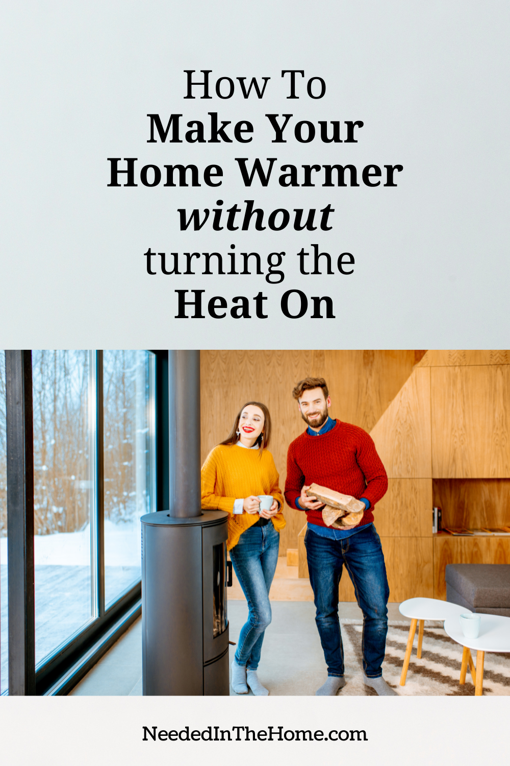 pinterest-pin-description how to make your home warmer without turning the heat on couple leaning on fireplace in winter drinking coffee holding wood neededinthehome